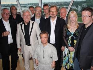25 Jahre Moderne Welt - Henning Tögel mit Geschäftspartnern
